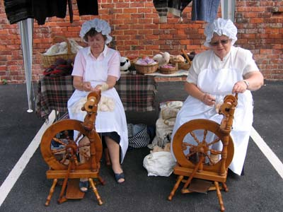 Ladies hard at work spinning and weaving